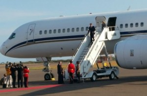 Britain's Prime Minister David Cameron exiting the plane at Norman Manley International today.