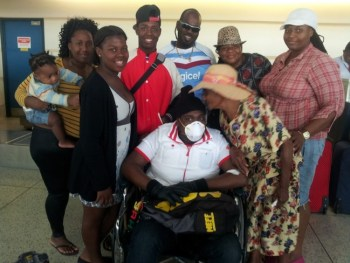 Joshua Sobers-Henry (centre) surrounded by family at the Grantley Adams International Airport before he left for treatment in 2014.