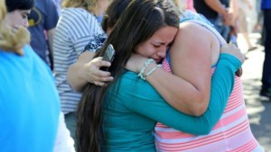 A woman being comforted as friends and family wait for students at the local fairground after a shooting  at Umpqua Community College  in Roseburg, Oregon, today.