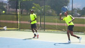 Barbados players Seanon Williams (left) and Darian King (right) go through their final paces before tomorrow's important Davis Cup tie. (Pictures by Morissa Lindsay)