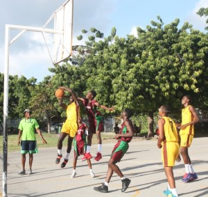 Chemar Steele (red sneakers) comes up with a big block against  Ellerslie.