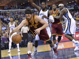 Cleveland Cavaliers forward Kevin Love reaches for the ball in the first half against the Memphis Grizzlies last night.