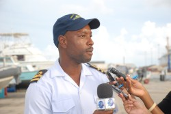 Lieutenant David Harewood speaking to the media about the Barbados contingent's operations in Dominica.