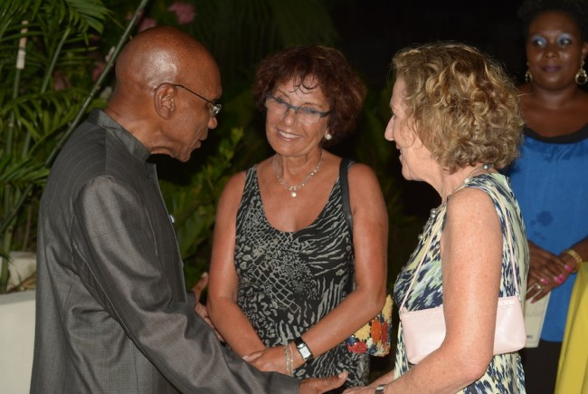 Central Bank Governor Dr DeLisle Worrell  engaging some of the enthused visitors  at the Dine With A Bajan pilot event.