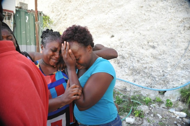 Walcott's wife Colleen Walcott (left) and daughter Jessica Best consoling each other.