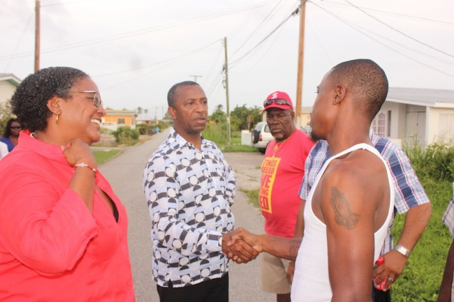 BLP candidate for Christ Church South, attorney Ralph Thorne, meets with a Christ Church resident as Opposition Leader Mia Mottley (left) looks on.