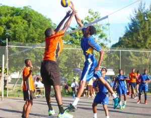 Jehu Lafeuillee of Combermere goes up and puts one past Shemar Bishop of Barbados Community College. (Pictures by Morissa Lindsay)
