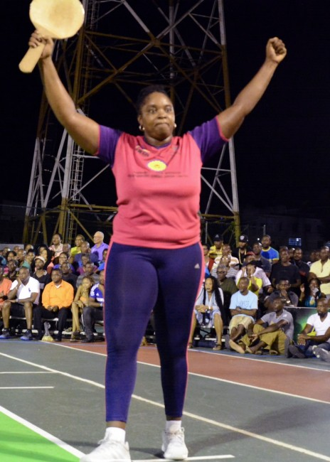 Kim Holder raises her hands in triumph after winning the road tennis title.