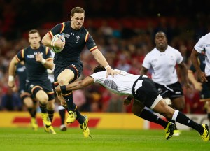 Metuisela Talebula of Fiji tries to tackle George North of Wales during today's game.