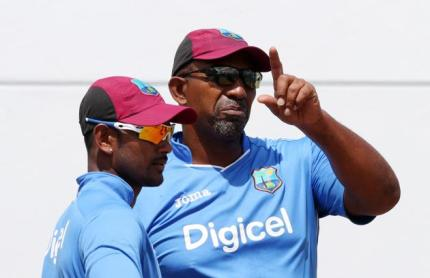 Phil Simmons (right)  with Denesh Ramdin.