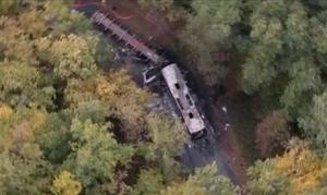 An aerial photo, taken from video, showing the scene after a truck and a bus transporting retirees on a day trip collided and caught fire today in wine country in southwest France, killing 42 people and badly injuring four others, authorities said.