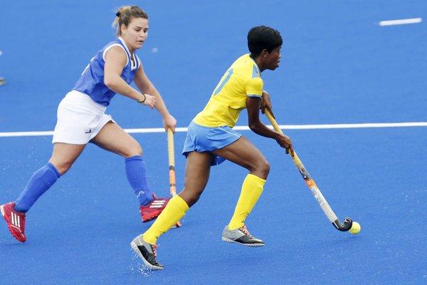 Barbados midfielder Patrina Brathwaite moving past her Brazilian marker.