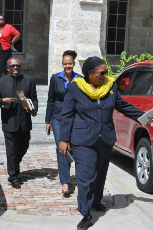 Embattled leader of the BLP Mia Mottley, leading Opposition colleagues Trevor Prescod (left) and Santia Bradshaw (centre) out of a recent session of Parliament.