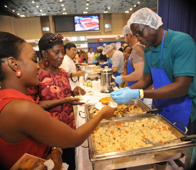 """Patrons anxious to get a taste of Calypso king William """"Classic"""" Hinds' dish, titled Something Fishy."""
