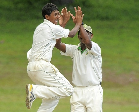 Gudakesh Motie (left) celebrates taking another Barbados Pride wicket.