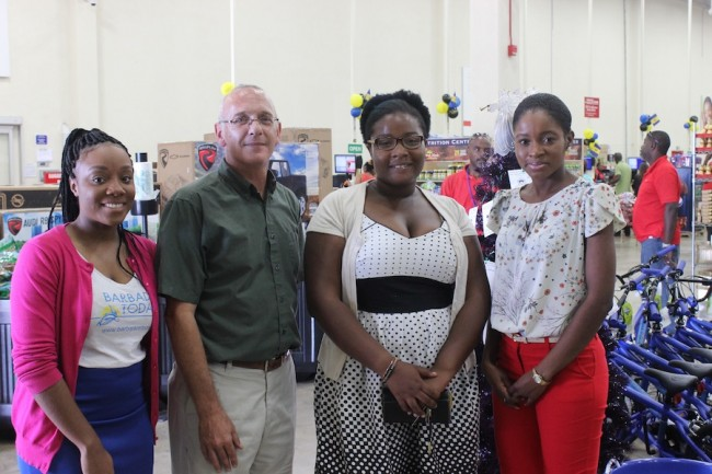 Cost U Less shopper Maria Rowe (second from left) poses with Barbados TODAY and Cost U Less officials during the launch of the Christmas promotion.