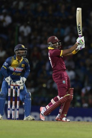 Dwayne Bravo swings to the boundary during his innngs.