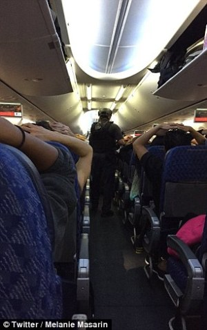 Passengers aboard the plane were told to put their hands on their heads as police searched for the dentist.