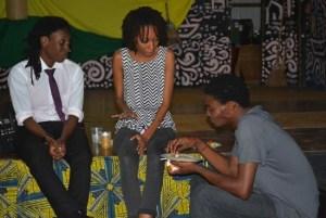Social activist Donnya Piggott (at left) sharing a light moment with community members.