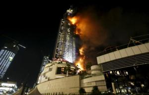 A fire engulfing The Address Hotel in downtown Dubai in the United Arab Emirates today.