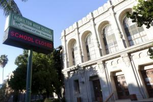 """A sign at Hamilton High School is pictured reading """"School Closed"""" in Los Angeles, California, today."""