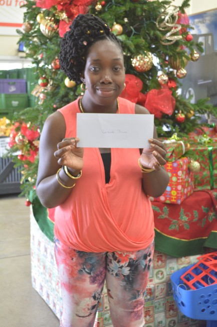 Ramonda Browne is all smiles holding her voucher.