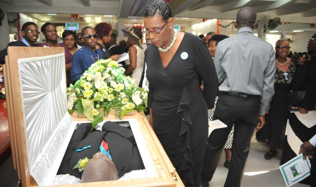 Perry's widow looking into his coffin.