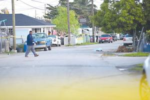 The body of a stabbing victim lying covered in the street in Yellow Elder yesterday morning.