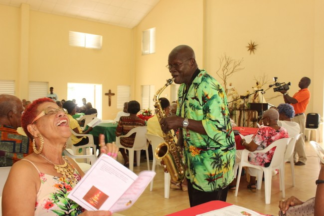 Jennifer Ashby enjoying the Christmas carol being played by Gerald Seaman Hunte at today's luncheon.