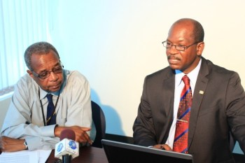 Chief Telecommunications Officer Reginald Bourne (left) and Programme Officer of the International Telecommunication Union Sylvester Cadette speaking to reporters today.