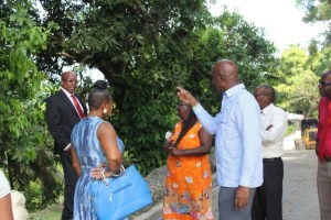 BLP MP George Payne and Minister of Transport and Works Michael Lashley in an animated exchange, as residents look on.