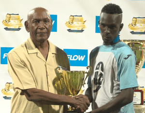 Jabbary Chandler accepting his MVP trophy from Chairman of the Christ Church West Constituency Council Winston Armstrong.