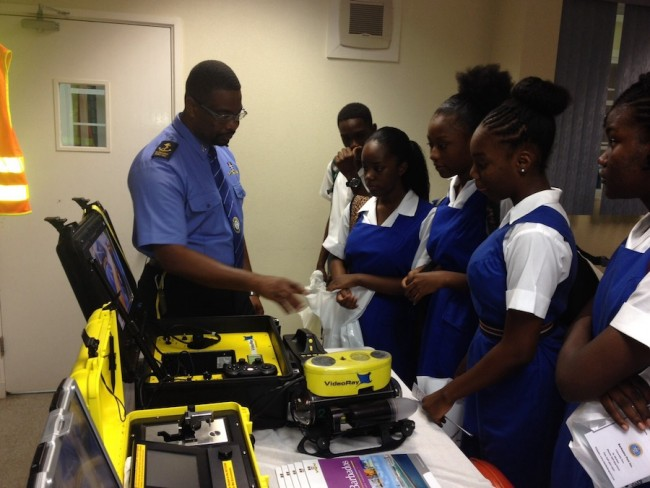 These Queen's College students learning more about the career choices at the Bridgetown Port.