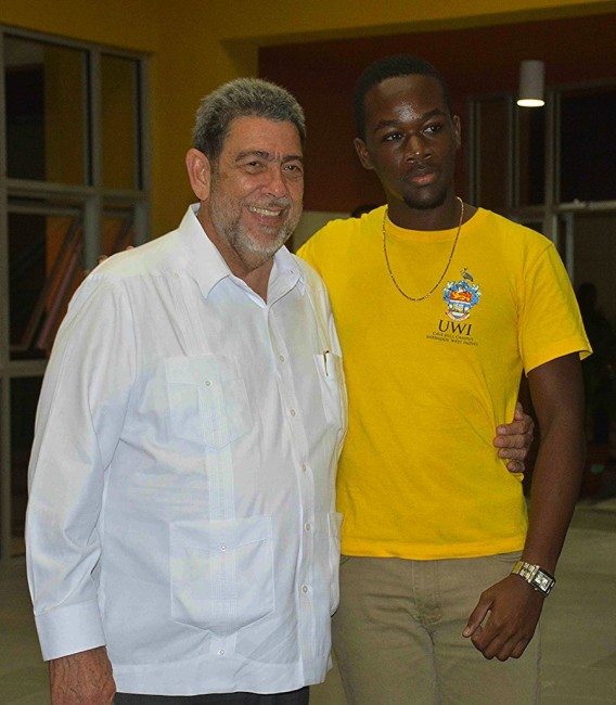 Prime Minister Dr Ralph Gonsalves with a Vincentian student.