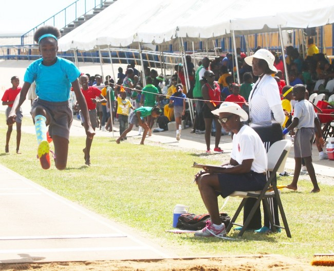 Amaria Williams of Blue House won the under-13 girls long jump with a leap of 3.87m.