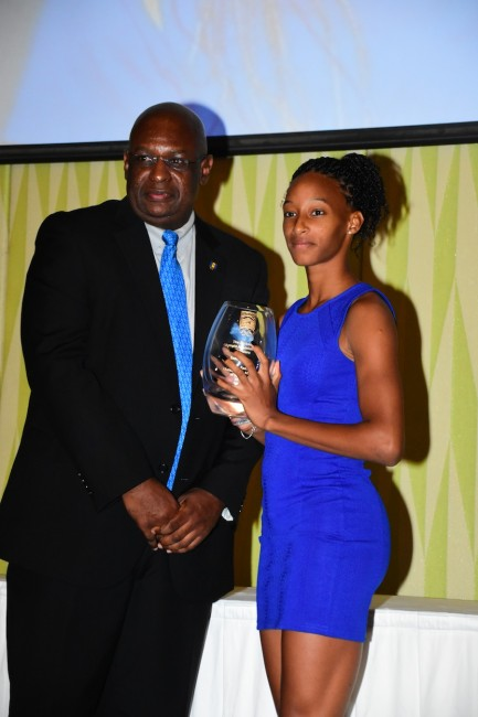 Barbados Olympic Association general secretary Erskine Simmons presents Junior Female Athlete Of The Year Sada Williams with her award.