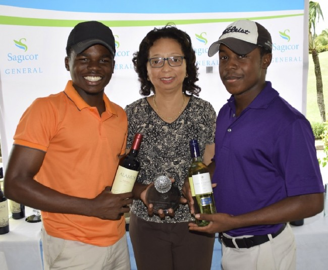 Brothers Matthew Clarke (left) and Joshua Jones emerged gross winners in the  siblings category and accepted their prizes from Betty-June Leacock of the Barbados Golf Club.