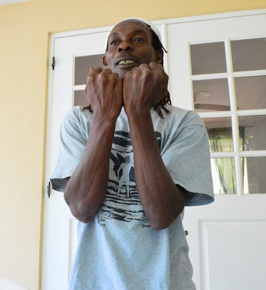 "Maurice Sandiford is upset over the treatment he received for having  a  ""five-bag"" of marijuana in his possession. Here, Sandiford shows how his hands were chained when he was sent to prison."