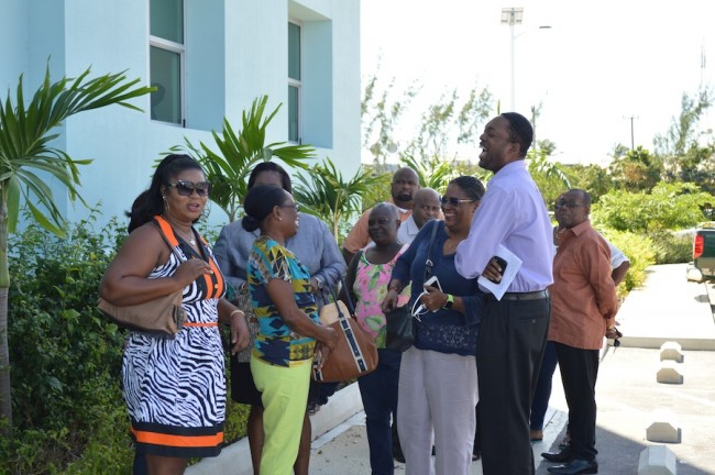 Barbados Labour Party candidate for St Peter, Colin Jordan, has a hearty laugh with Opposition Leader Mia Mottley and concerned residents from St Peter and St Joseph at the BWA headquarters, the Pine.