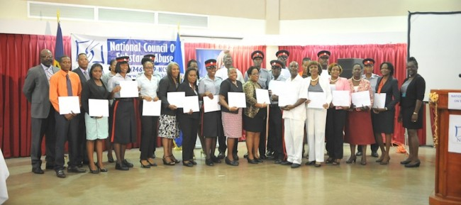 Graduates who participated in the Prevention Of Drug Abuse segment of the course in group photograph with Adriel Brathwaite.