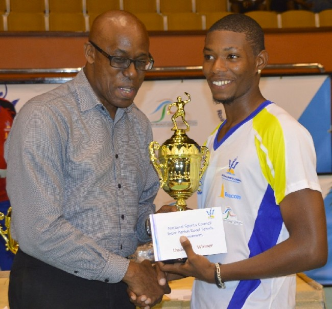 "Darius ""Baraccus"" Gaskin accepts his trophy from Jerry Blenman of the NSC after defeating Emar Edwards in the under-21 final."