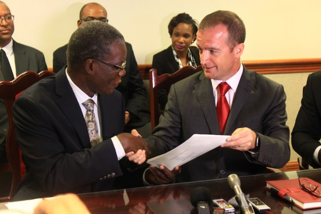 Acting Permanent Secretary in the Ministry of the Civil Service Allyson Forte left and general manager of Digicel Business Martin Keogh, following the signing of the contract.