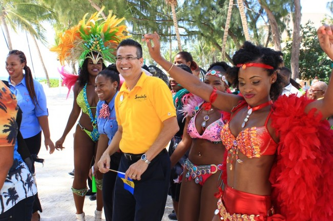 "General manager of Sandals Barbados, Ferry Zievinger (at left), and some of the Sandals ""revellers""."