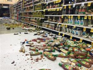 In this photo provided by Vincent Nusunginya, items fallen from the shelves litter the aisles inside a Safeway grocery store following a magnitude 6.8 earthquake on the Kenai Peninsula yesterday.
