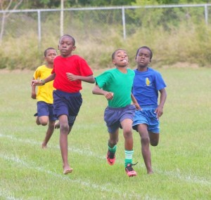 Jacobie Telemaque of Green House had stiff competition but did well to hold off main rivals Kobe Burgess and Gabriel Brewster of Red House in the under-11 boys 400m showdown. (Pictures by Morissa Lindsay)