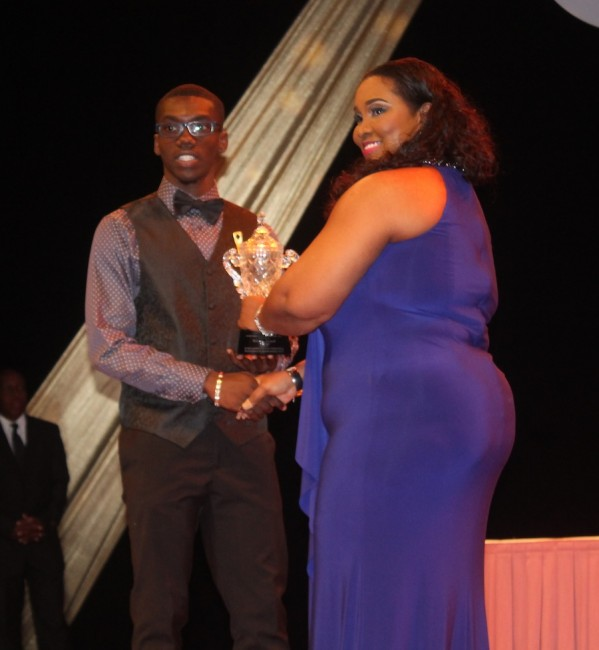 Junior Male Sportsperson for 2015 Rivaldo Leacock receives his award.