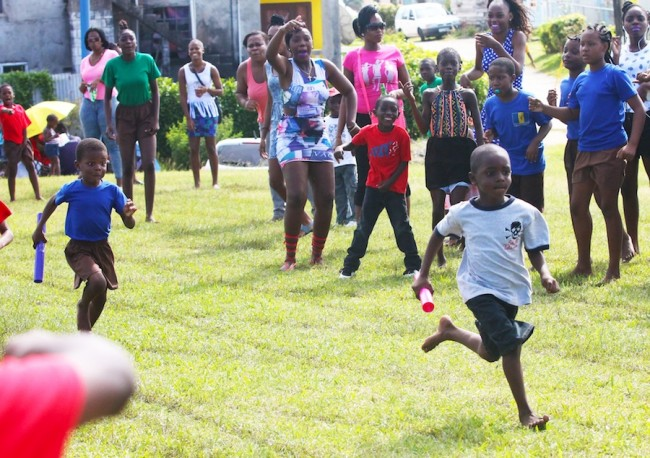 Kalique Holder of Blue House got the better of Amun Moore of Green House in the under-seven boys 4x100m relay.