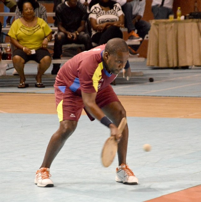 "Kerry ""TC"" Francis of St Lucy makes a forehand return enroute to his upset win over Julian ""Michael Jackson"" White ."