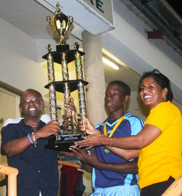 Minister of Sports  Stephen Lashley and Senator Esther Byer are all smiles as they present captain Tyrique Holder with the trophy. (Pictures by Morissa Lindsay)
