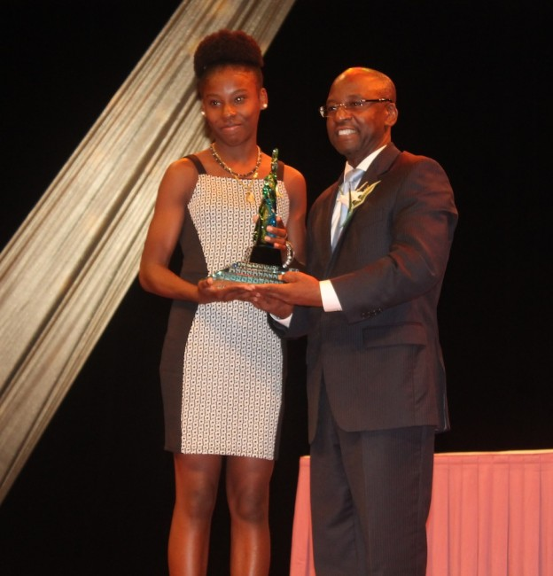 Multi-talented Mary Fraser collects her award from Minister of Sports Stephen Lashley.
